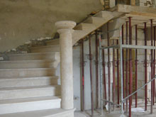 the-stone-staircase-is-installed-in-the-manor-house-conversion