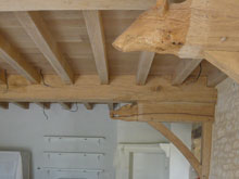 the-ends-of-the-beams-have-been-carved-into-boars-heads-in-the-manor-house-kitchen